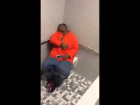 Guy throws trash bin at sleeping dude